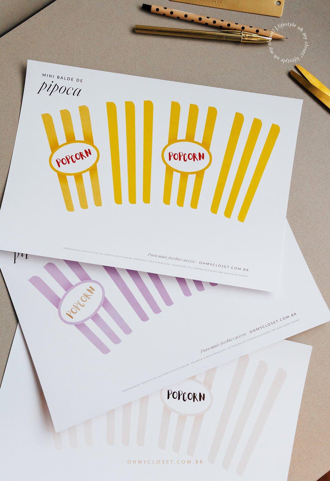 Folhas impressas com o molde do mini balde de pipoca para impressão.